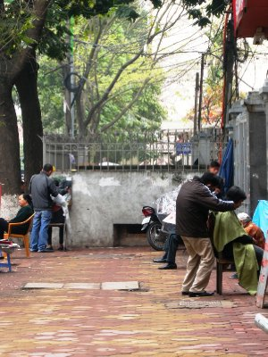 The open air Barber shop in Hanoi!
