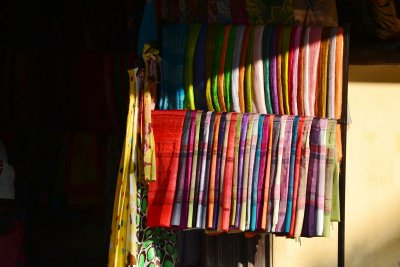 Beautiful silk scarves shine in the dying sunlight