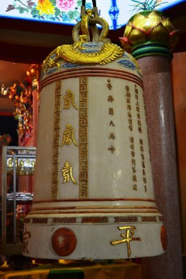 A beautiful ceremonial bell and huge candles inside the Temple
