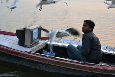 Catching the breakfast show on the Ganges!