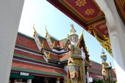 A temple within Wat Phra Kaeo guarded by two huge demonic statues