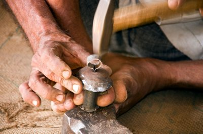 Making the copper bells in the Kutch - feet are very useful!