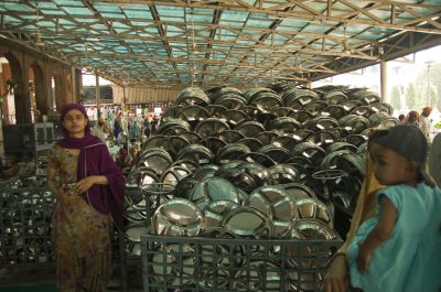 Handing out thali plates in the Golden Temple kitchen
