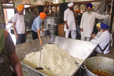 Raking rice in the Golden Temple kitchen