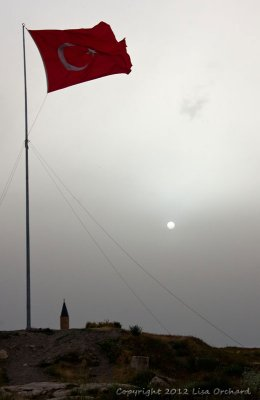 Sun on its way down over Lake Van and the Turkish Flag