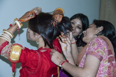 Vibha and Garima getting Abhilasha ready
