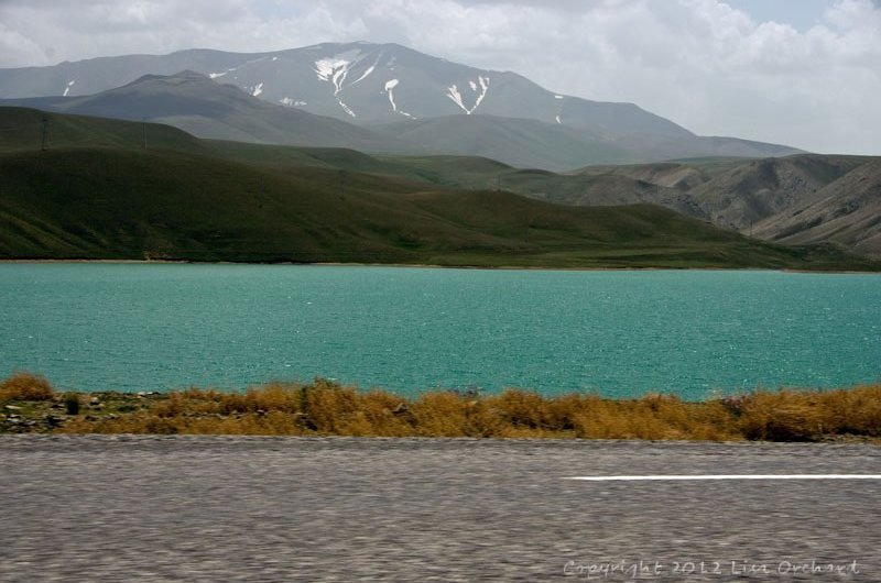 Fantastically ice-blue lake on the road.