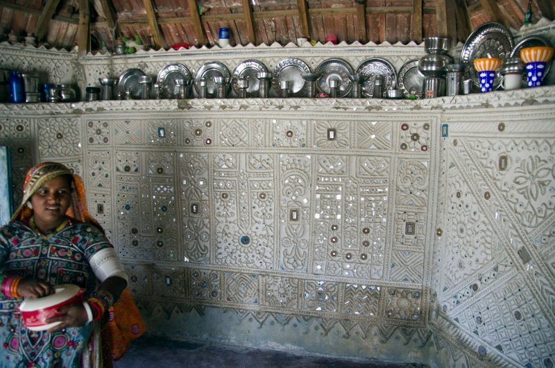 Mirror-work inside a Kutch village hut