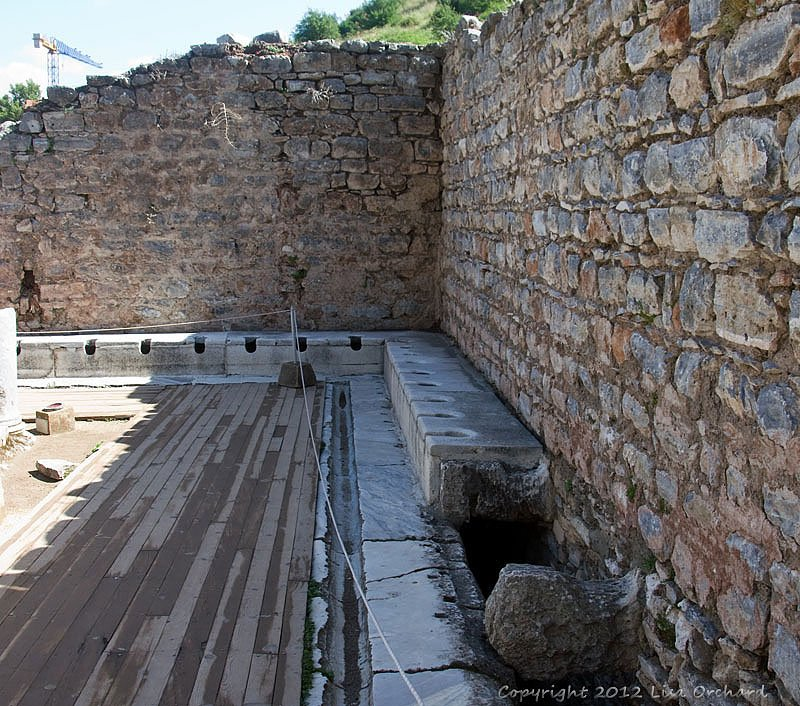 The public toilets.  Patron would send their slaves in ahead to warm the seats!