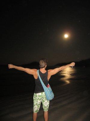 J on beach watching the moon set