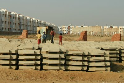 Children Playing at Construction Site