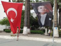 Proud flags flying in the port of Bodrum - the national flag of Turkey, Ataturk.
