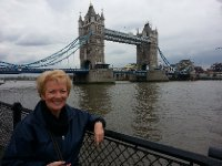 Anne on the Thames - London Bridge in the background, early evening.