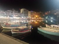 The centre of town - Agios Nikolaus. Fishing boats are moored on the lake.
