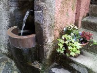 A quaint water fountain in the town of Fiumelatte.