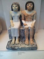 Ancient sculpture of a husband and wife in the Egyptian Exhibition.
