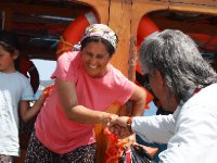 Delightful lady - the wife of our Captain - being helped aboard to help cook our lunch - Kekova.