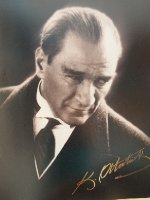 One of the photos of Mustafa Kemal Ataturk on display in our hotel. His signature is a popular Turkish logo.