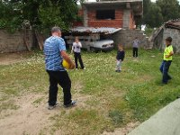 Red playing footy with the kids of the family who invited us for lunch.