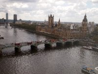 View from the London Eye of the Houses of Parliament and Westminster Bridge - complete with evenly spaced London Double Decker buses.