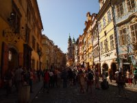 Prague street on a busy Sunday afternoon.