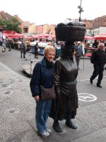 Anne alongside a hard working Turkish woman - famous statue in Zagreb's Marketplace.