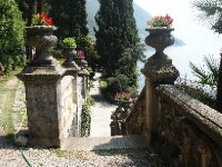 Age old urns provide an inviting walk down to the Gardens.