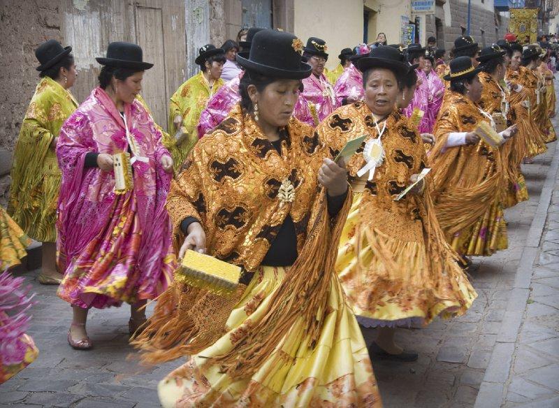 Dancers: ladies in orange and pink