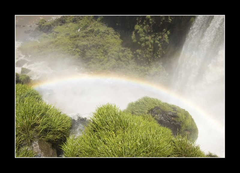 Rainbow at bottom of falls