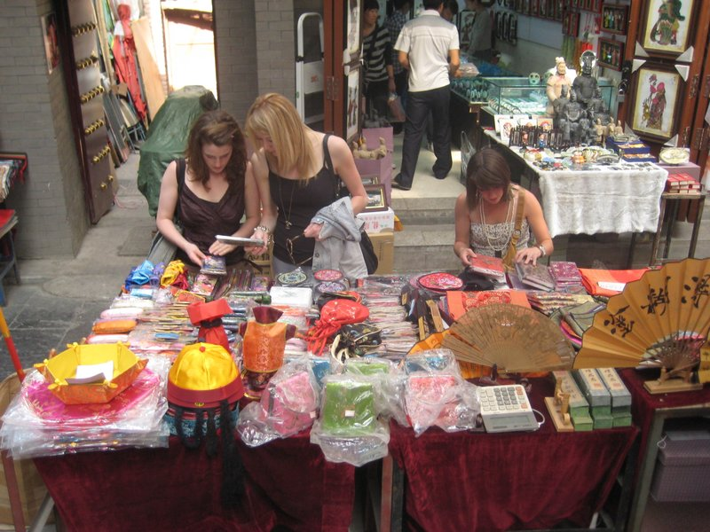 The girls picking their way through tourist knick-knacks