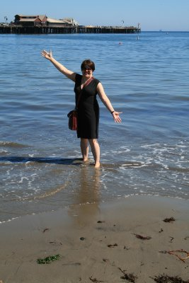 Clare dipping her toes in the Pacific Ocean