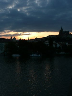 Vltava river, Mala Strana and Prague Castle at sunset