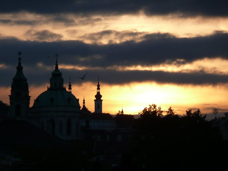 Spires of Mala Strana during sunset incl. fit bird