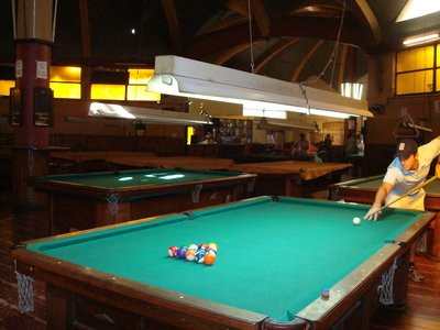 Playing pool in old school pool hall in Mendoza