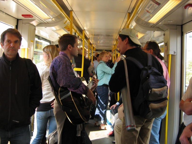 Street musicians in subway train