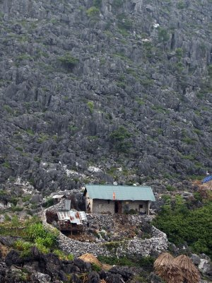 A house built on rocks on the steep side of a mountain