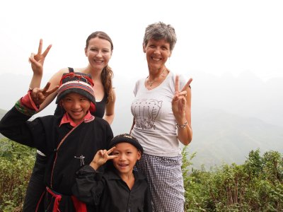 Laura, Amanda and two little children in the mountains