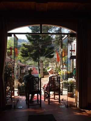 Parents enjoying the sun in the doorway of the Thai Binh