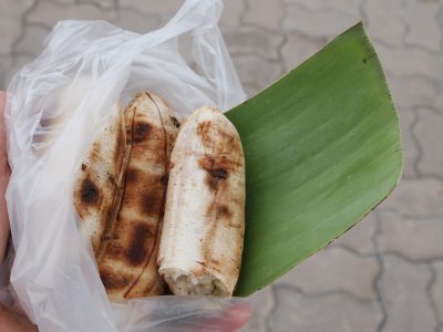 Grilled green banana snack with banana leaf plate, by the mighty Mekong