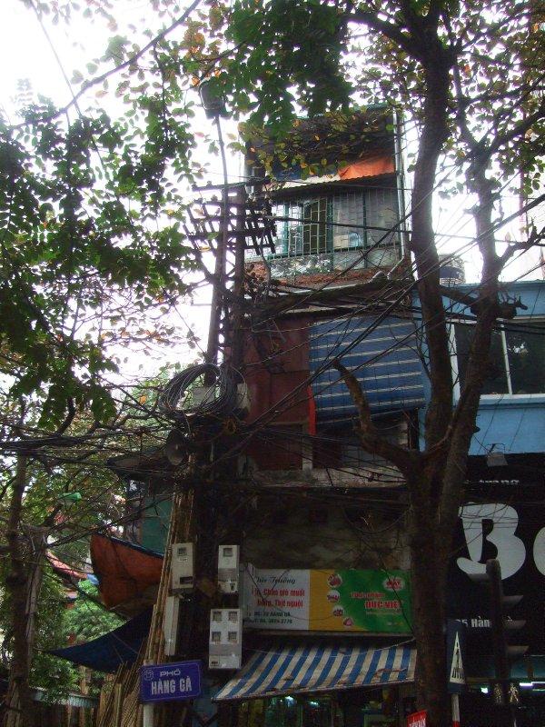 Shop house on the corner of Bamboo Street, Hang Ga and Lo Ren, Hanoi Old Quarter