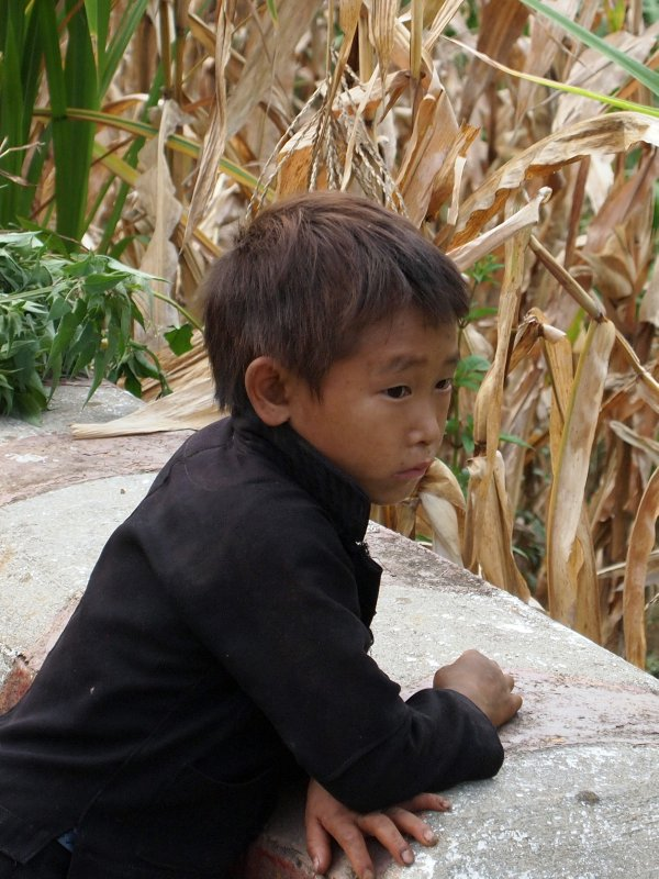 Minority child, on his own by the side of the road.