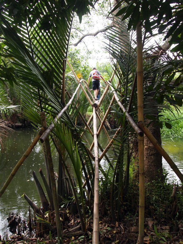 Nick on the (scary) monkey bridge, fruit gardens in the Mekong Delta