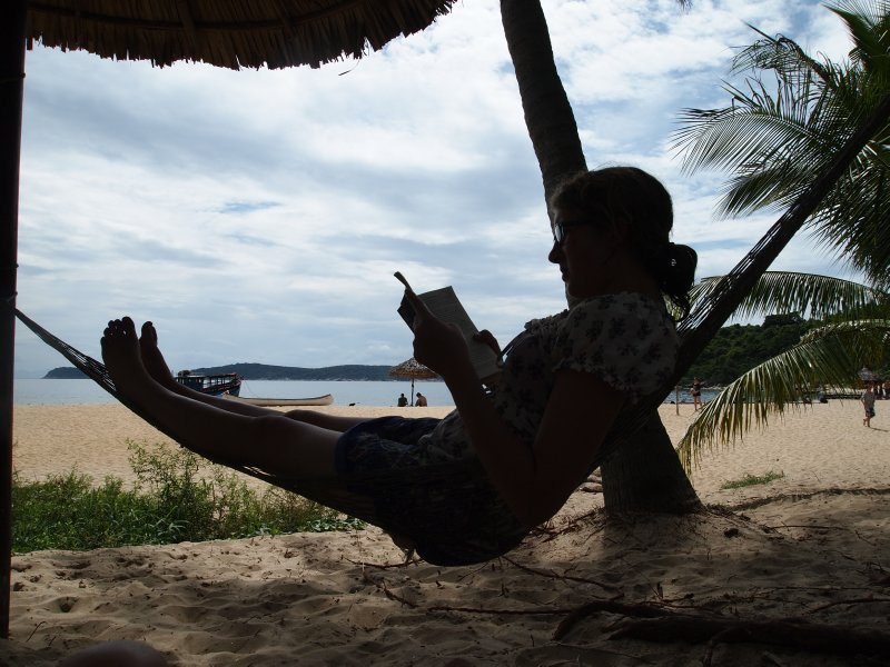 Daisy reading after a busy morning snorkelling and having lunch............