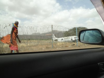 Drive by shooting of crashed plane and Turkana woman at Loki Airport