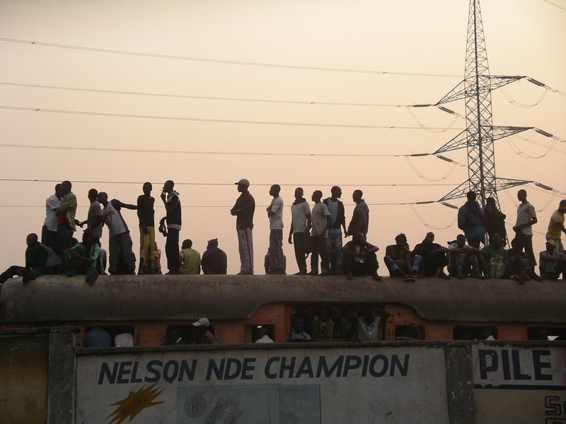 Street kids on the roof of the Kinshasa evening train