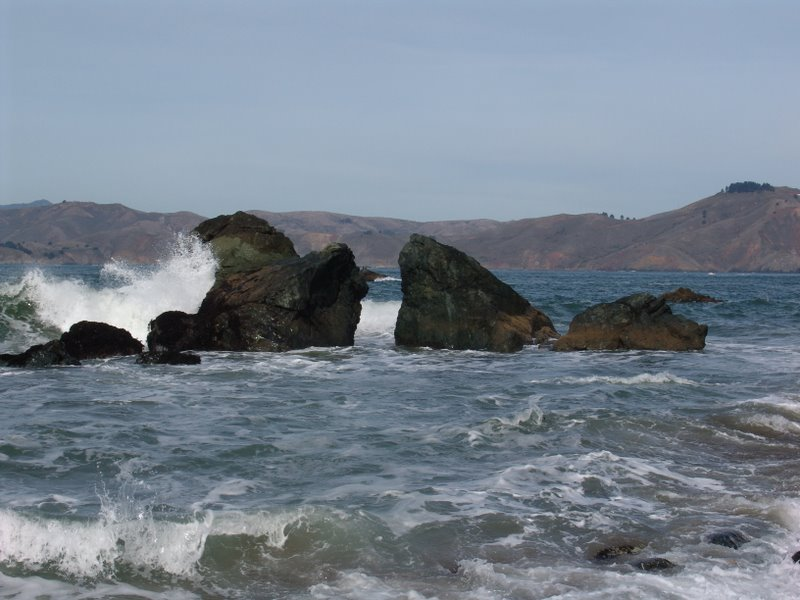 Waves crashing through rocks