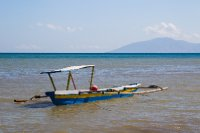 A native fishing boat with double skid stabilisers in timor leste