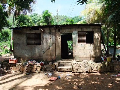 House in the village. No windows, no door, but we have a TV!