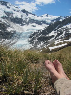 Resting on cascade saddle and enjoying views to dart glacier on Rees-Dart track