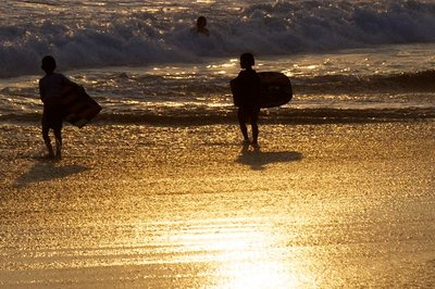 Surfers in the sunset
